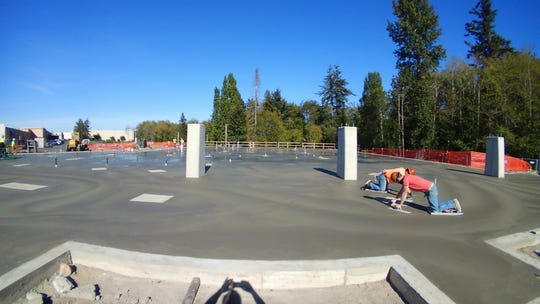 Construction workers set the concrete slab for the future VA Puget Sound community-based outpatient clinic in Silverdale.