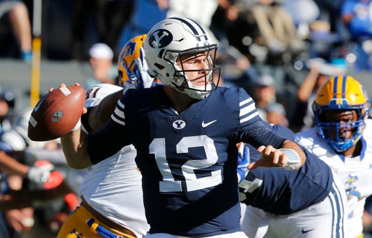 BYU quarterback Tanner Mangum was a prep star in Idaho when Huskies coach Chris Petersen was at Boise State.