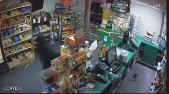 Surveillance video shows two people breaking into Burnt Mill News shortly after 4 a.m. Thursday.