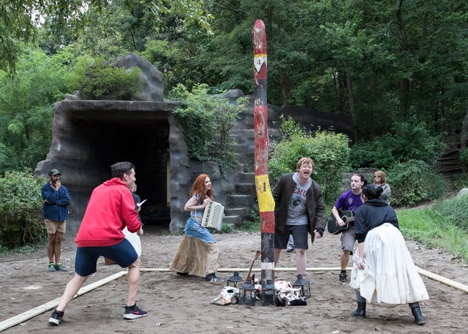 "The cast of ""The Sleepy Hollow Experience"" perform a musical number that will eventually be located in the drained pond of the Sugarloaf Mountain Amphitheater, where the audience will be able to come on stage and watch action close-up."