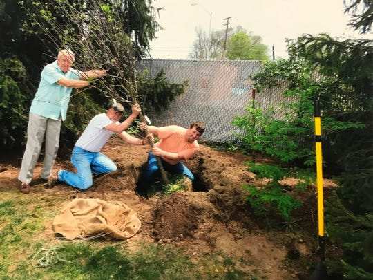 In a submitted photo meant to resemble the planting of the American flag on Iwo Jima during World War II, Whitey Coates, left, Rich Simpson, center and Clay Simpson plant one of the new trees in Chillicothe Veterans Memorial Park recently for the Chillicothe Tree Commission. Coates served during the Korean War, the elder Simpson served in the Marine Corps and the younger Simpson was a Marine who served in Afghanistan.