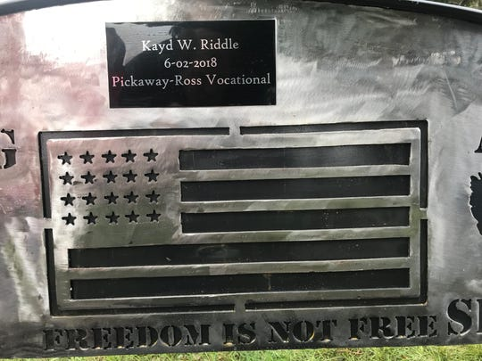 Kayd Riddle's name was added to the bench above the flag design on the bench he created that now sits in Chillicothe's Veterans Memorial Park.