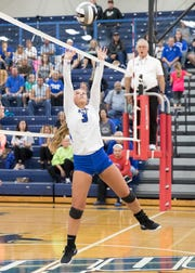 Southeastern' s Lauren Goebel sets the ball up to be spiked by a fellow team mate Thursday, September 27, 2018, at Southeastern High School.