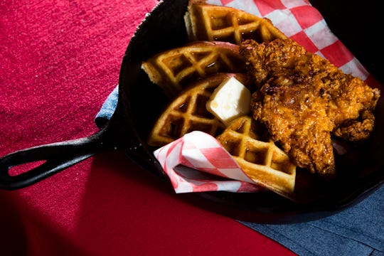 The chicken and Waffles served with real maple syrup at Main Street Tavern in Covington on Friday, Sept. 28, 2018.