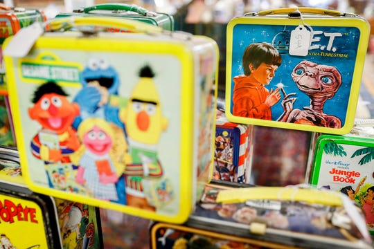 In this Friday, Sept. 21, 2018 photo, vintage lunchboxes are displayed at Main Auction Galleries Inc., in downtown Cincinnati. Karp, a longtime auctioneer of Cincinnati-area estates has come upon a Baby Boomer delight: hundreds of vintage lunchboxes featuring the heroes of their childhood's comic books, TV shows, cartoon strips, movies and more. Bids start at $20. (AP Photo/John Minchillo)