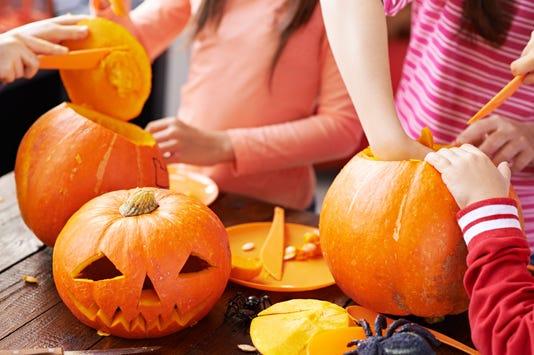 Children Making Halloween Pumpkin Decoration For People