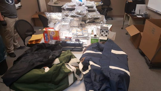 Almost 100 pounds of marijuana, drug paraphernalia, marijuana oil and $2,000 in cash were confiscated in a drug bust in Clarksville on Thursday.