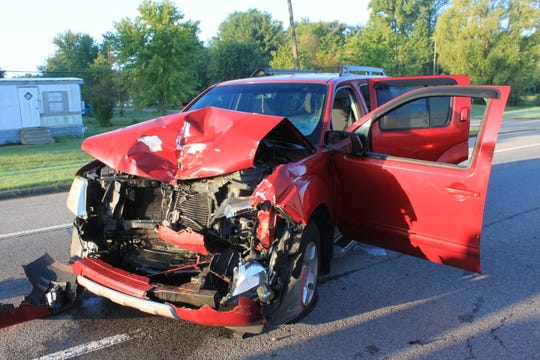 A woman was injured Friday after crashing into a stopped firetruck on Tiny Town Road.