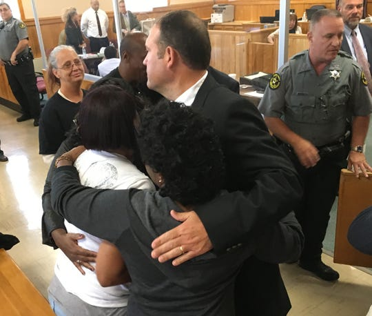 Cumberland City Police Chief Jason Gillespie hugs family members of Donnie Cooksey after a guilty verdict of two people involved in his shooting death.