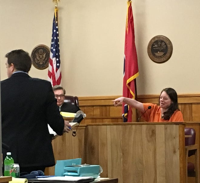 Amy Hankins points to her sister Ashley to identify her during Ashley Hankins' first-degree murder trial for the slaying of Donnie Cooksey.