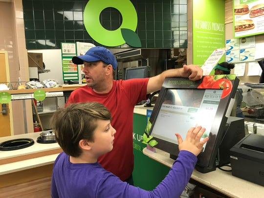 Gabriel Lapano orders his favorite QuickChek meal, a grilled cheese with extra bacon, on Sept. 27 at the Fanwood location on North Avenue, while his father chats with an employee.