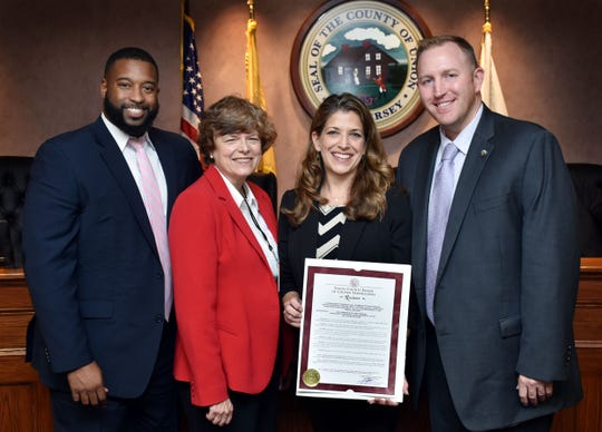 Union County Freeholder Vice Chairman Bette Jane Kowalski and Freeholders Christopher Hudak and Mohamed Jalloh present a resolution to Linden High School Teacher Barbara Brady congratulating her upon being selected as Union County Teacher of the Year by the New Jersey Department of Education. The dance and physical education teacher has been teaching in Linden for 20 years.