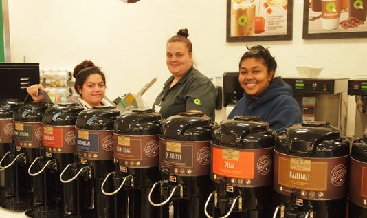 Team Members Prepare Coffee Wall
