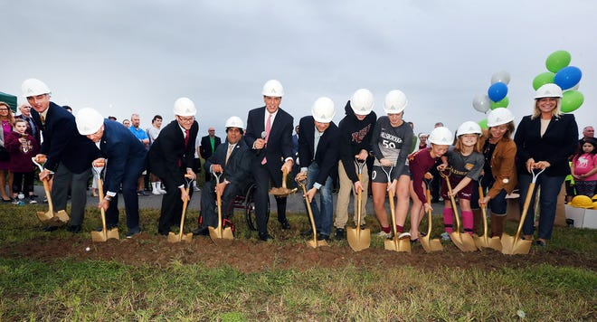 Freeholder Director Patrick Scaglione and Freeholder Mark Caliguire join Hillsborough and company officials in a ceremonial groundbreaking for the new APEX Sports & Events Complex next to Mountain View Park.