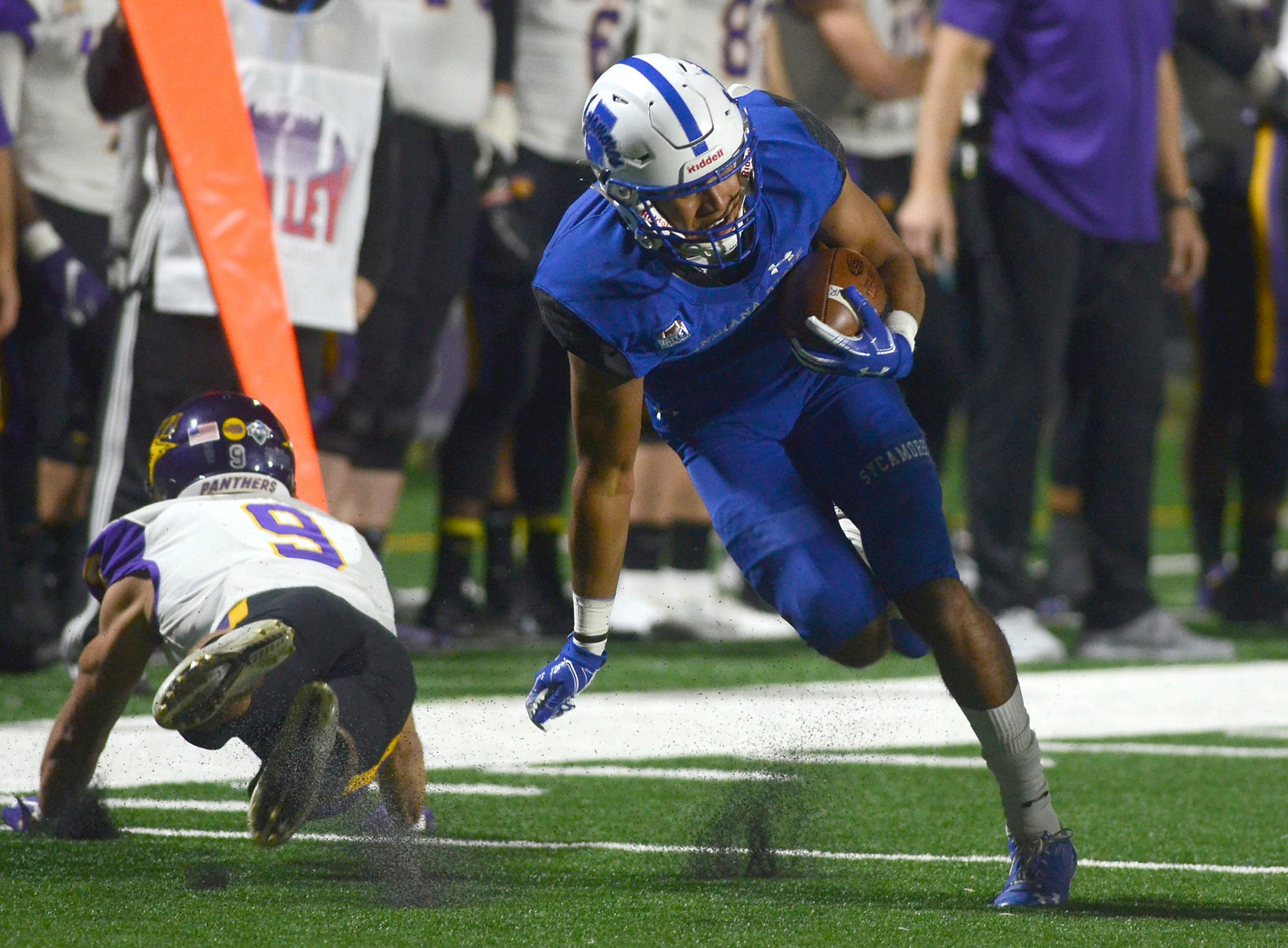 Indiana State wide receiver Dante Hendrix scrambles for yardage after he avoided a tackle by Northern Iowa's Xavior Williams during an NCAA college football game Thursday, Sept. 27, 2018, in Terre Haute, Ind.