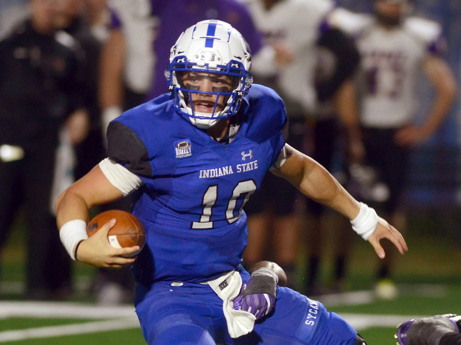 Indiana State quarterback Ryan Boyle is sacked by Northern Iowa's Brawntae Wells during the second half of an NCAA college football game Thursday, Sept. 27, 2018, in Terre Haute, Ind.