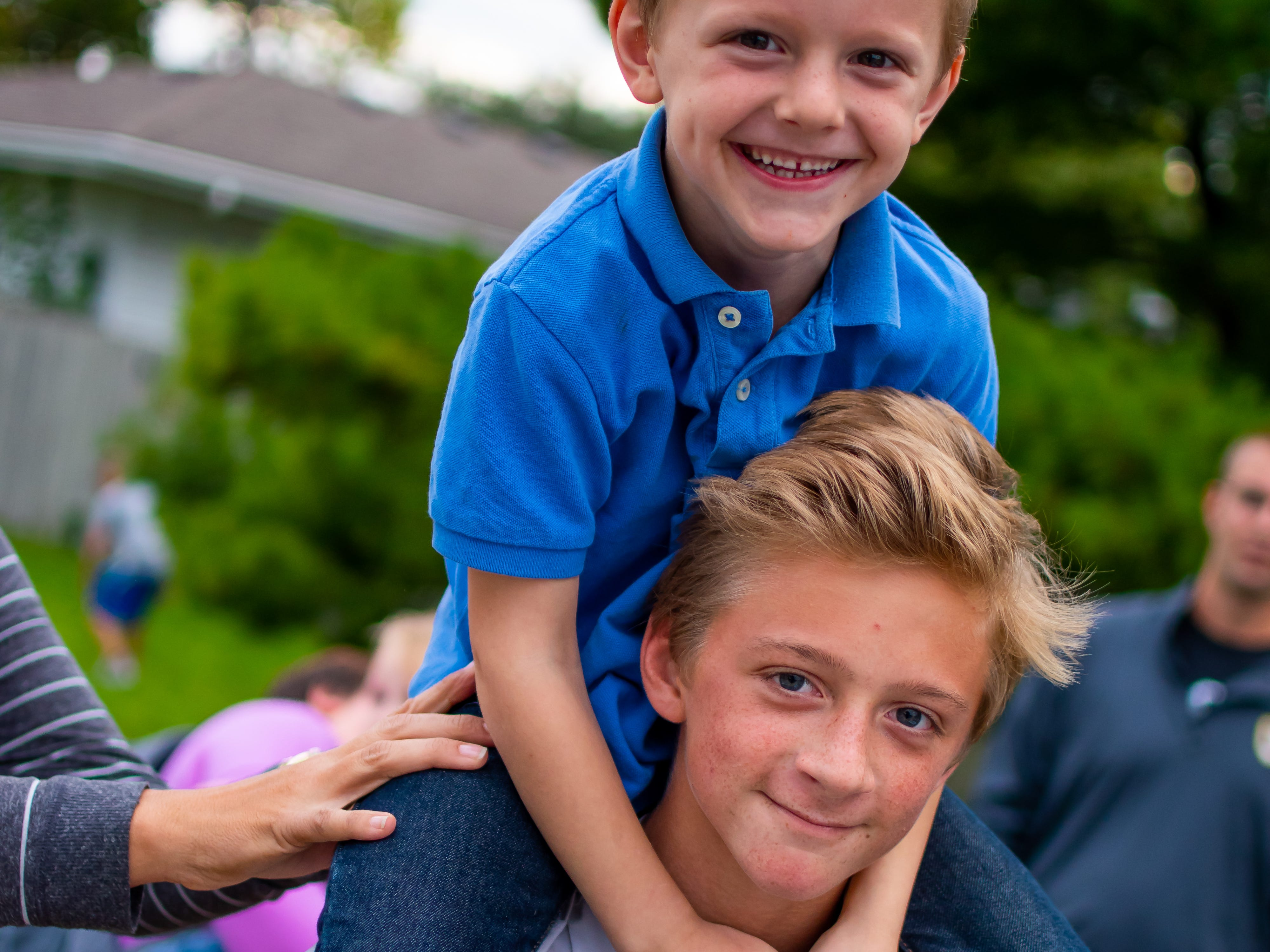 Everett, 4, and Andrew Fleming, 13, both of Waukee wait  for the Waukee Homecoming Parade on Thursday, September 27, 2018 in Waukee.