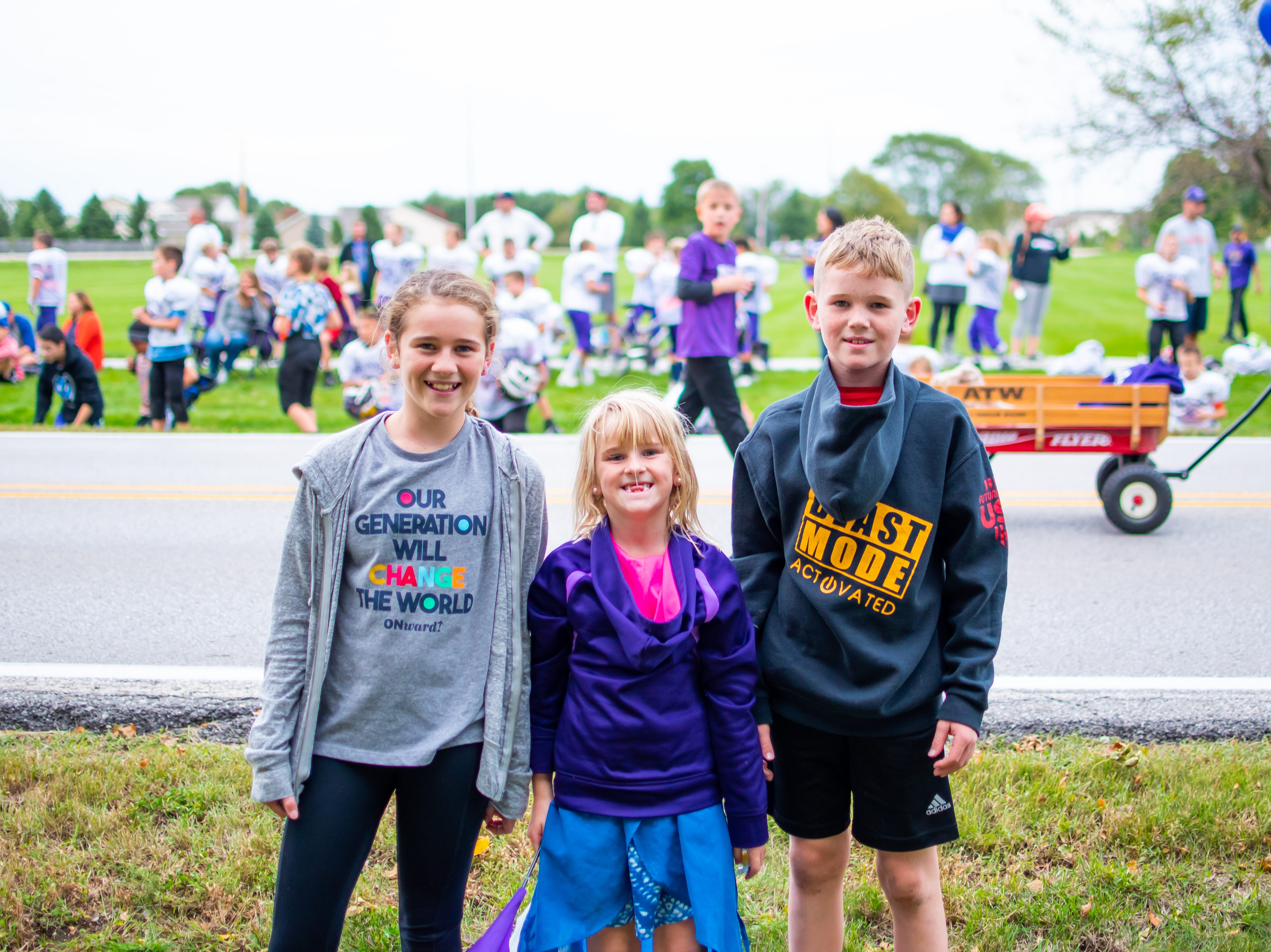 Lili, 12, Maggie, 7, and Tate Boyd, 10, all of Waukee enjoy all the excitement of the Waukee Homecoming Parade on Thursday, September 27, 2018 in Waukee.