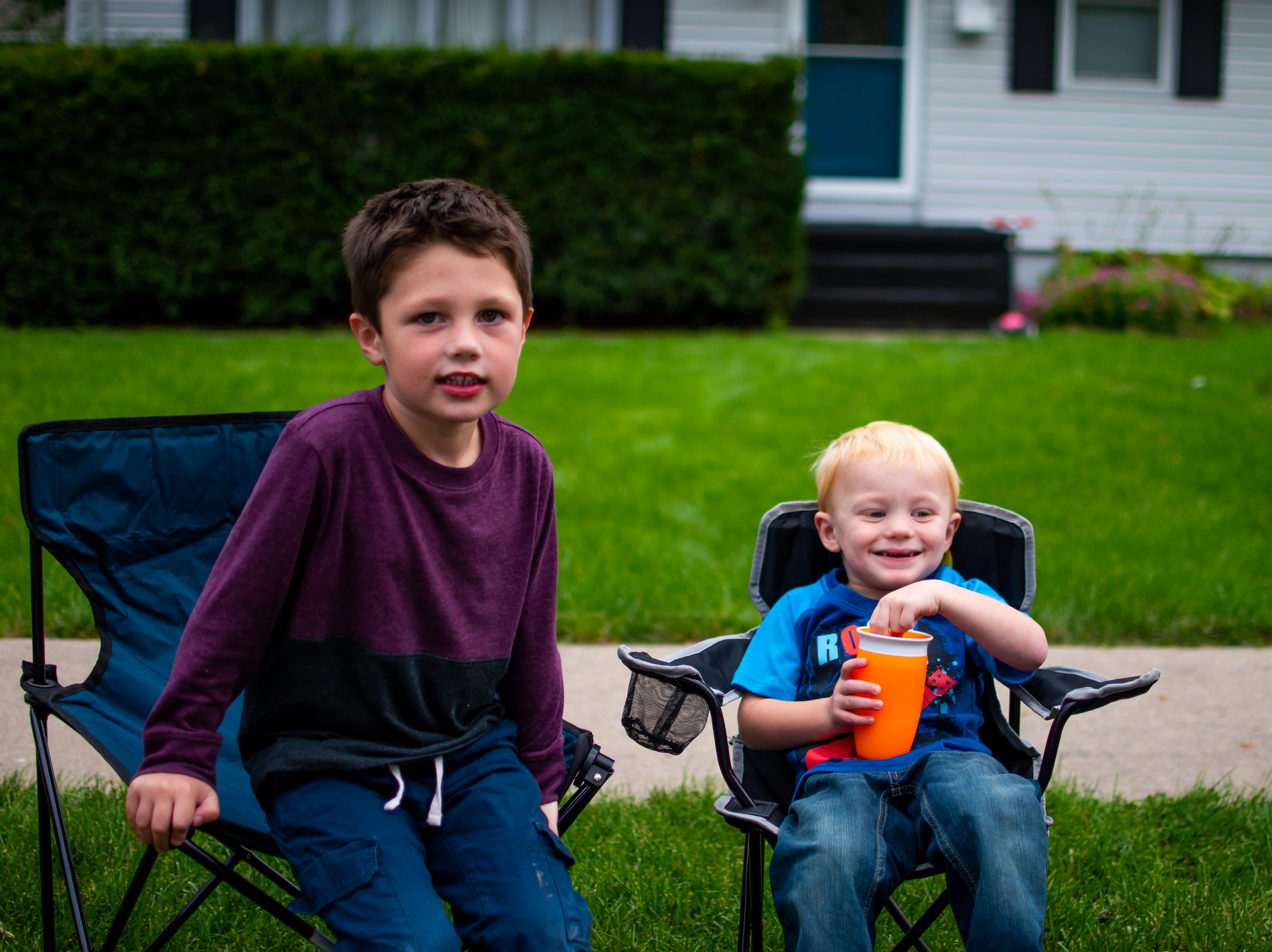 Winston Newberry, 4, and Kindin Cooper, 3, both of Waukee wait for the Waukee Homecoming Parade on Thursday, September 27, 2018 in Waukee.