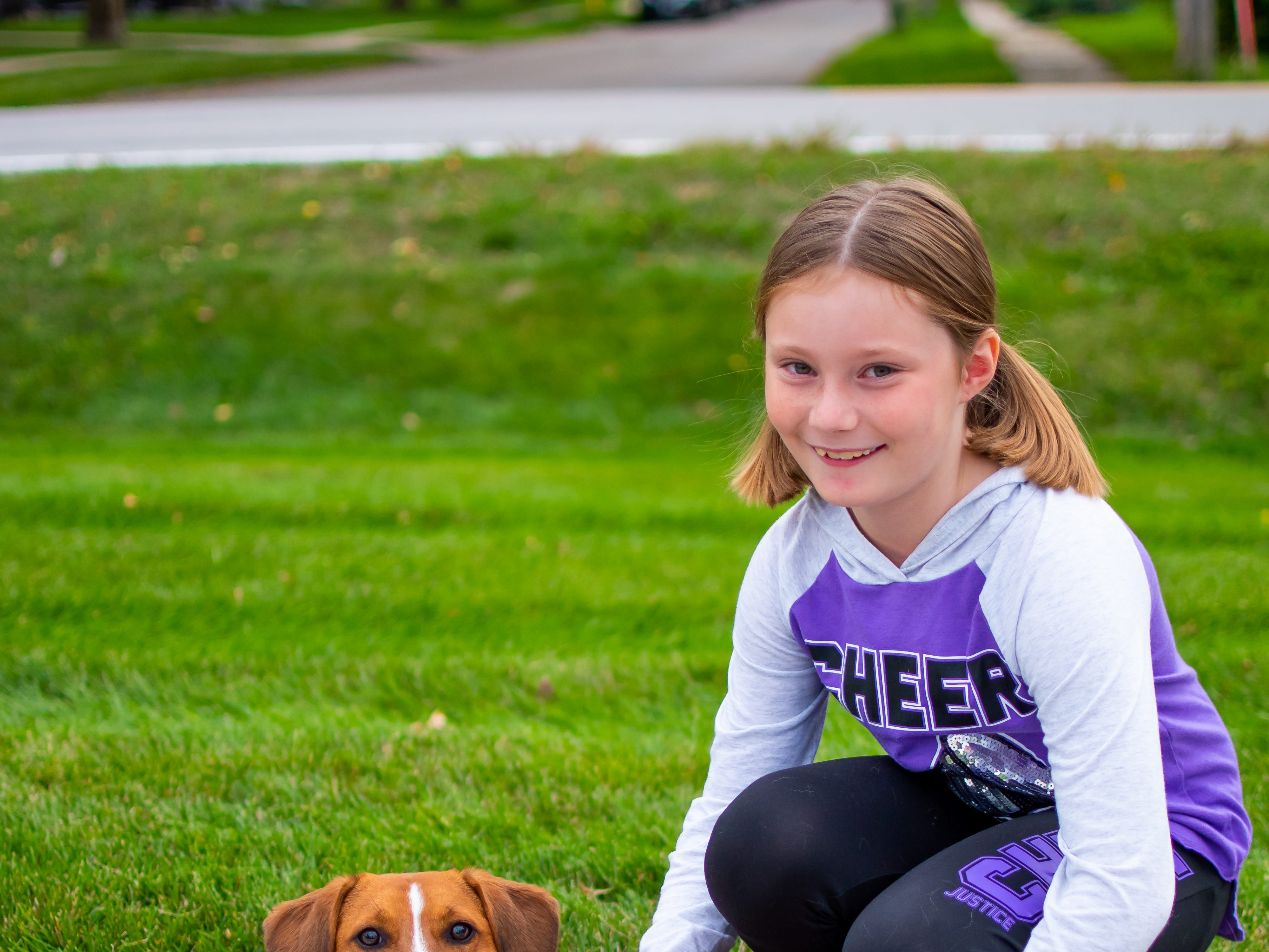 Kendall Curran, 9, and Lexie, both of Waukee wait  for the Waukee Homecoming Parade on Thursday, September 27, 2018 in Waukee.