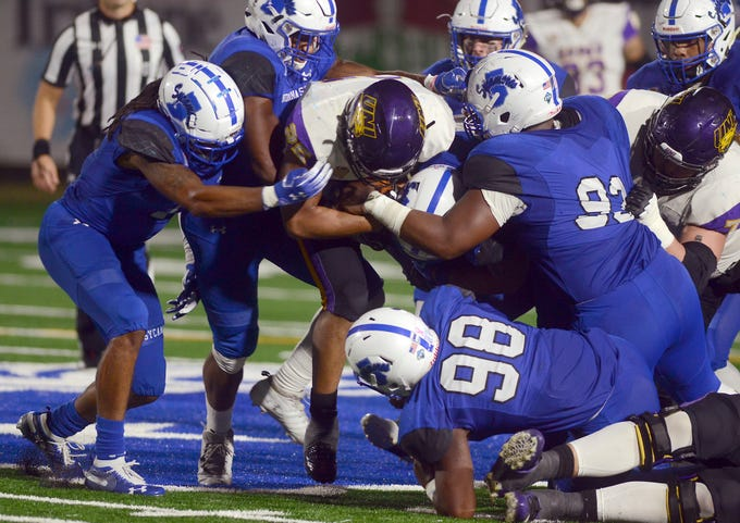 Indiana State's defense swarms Northern Iowa's Trevor Allen during an NCAA college football game Thursday, Sept. 27, 2018, in Terre Haute, Ind.