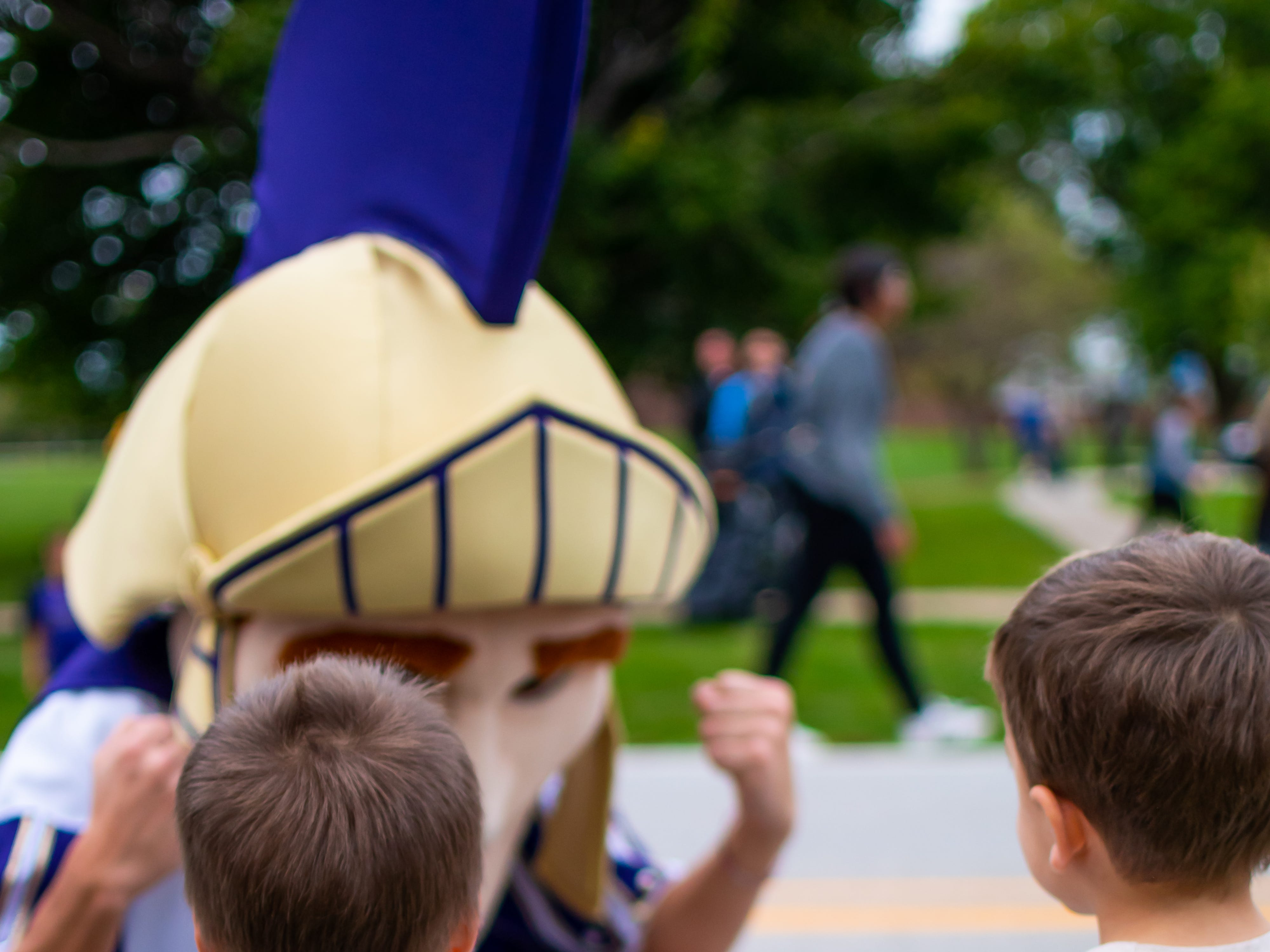 Brooks, 3, and Beckett Keenan, 3, both of Waukee give high fives to the Waukee mascot at the Waukee Homecoming Parade on Thursday, September 27, 2018 in Waukee.