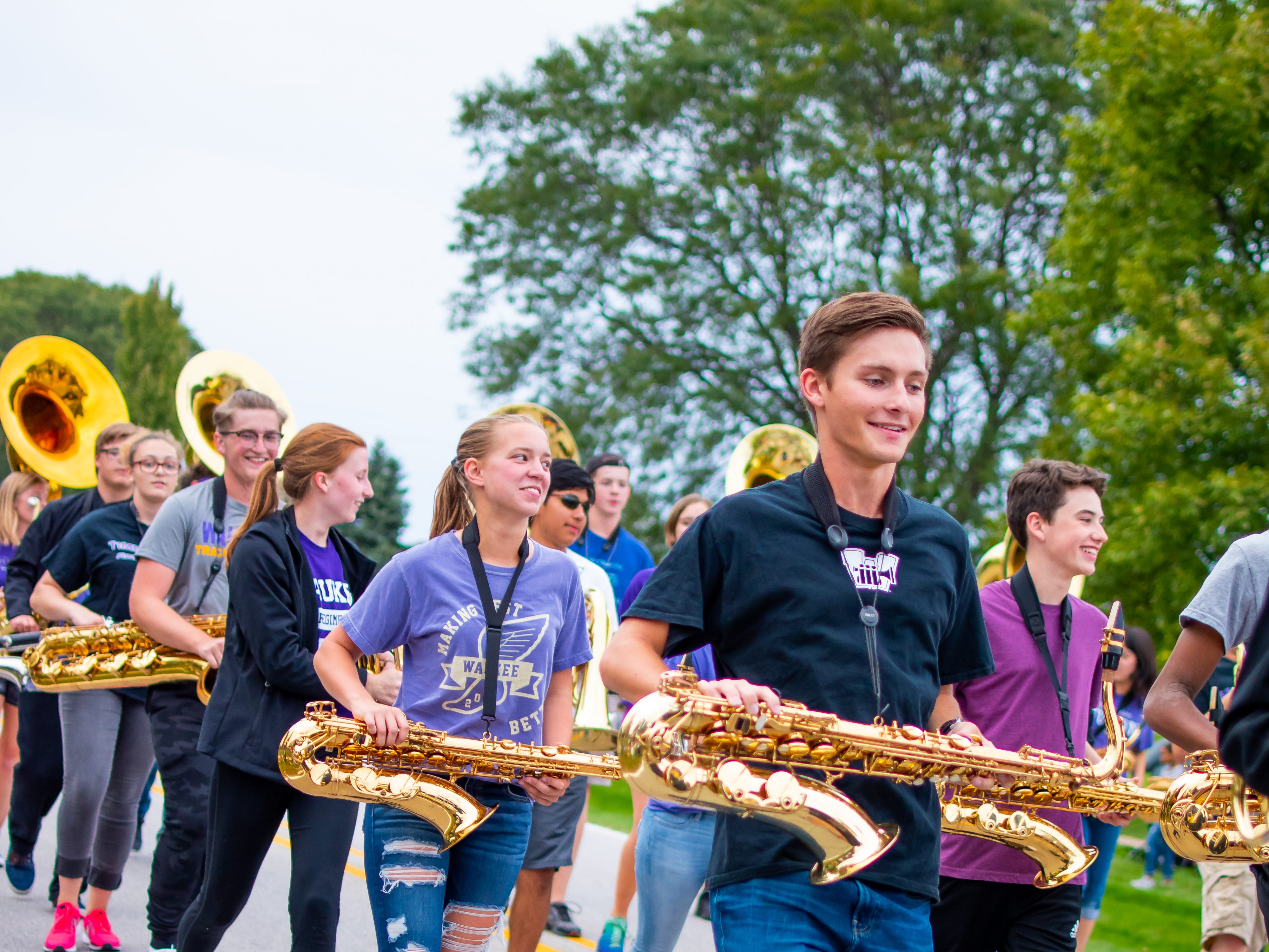 The Waukee high school band march in the Waukee Homecoming Parade on Thursday, September 27, 2018 in Waukee.