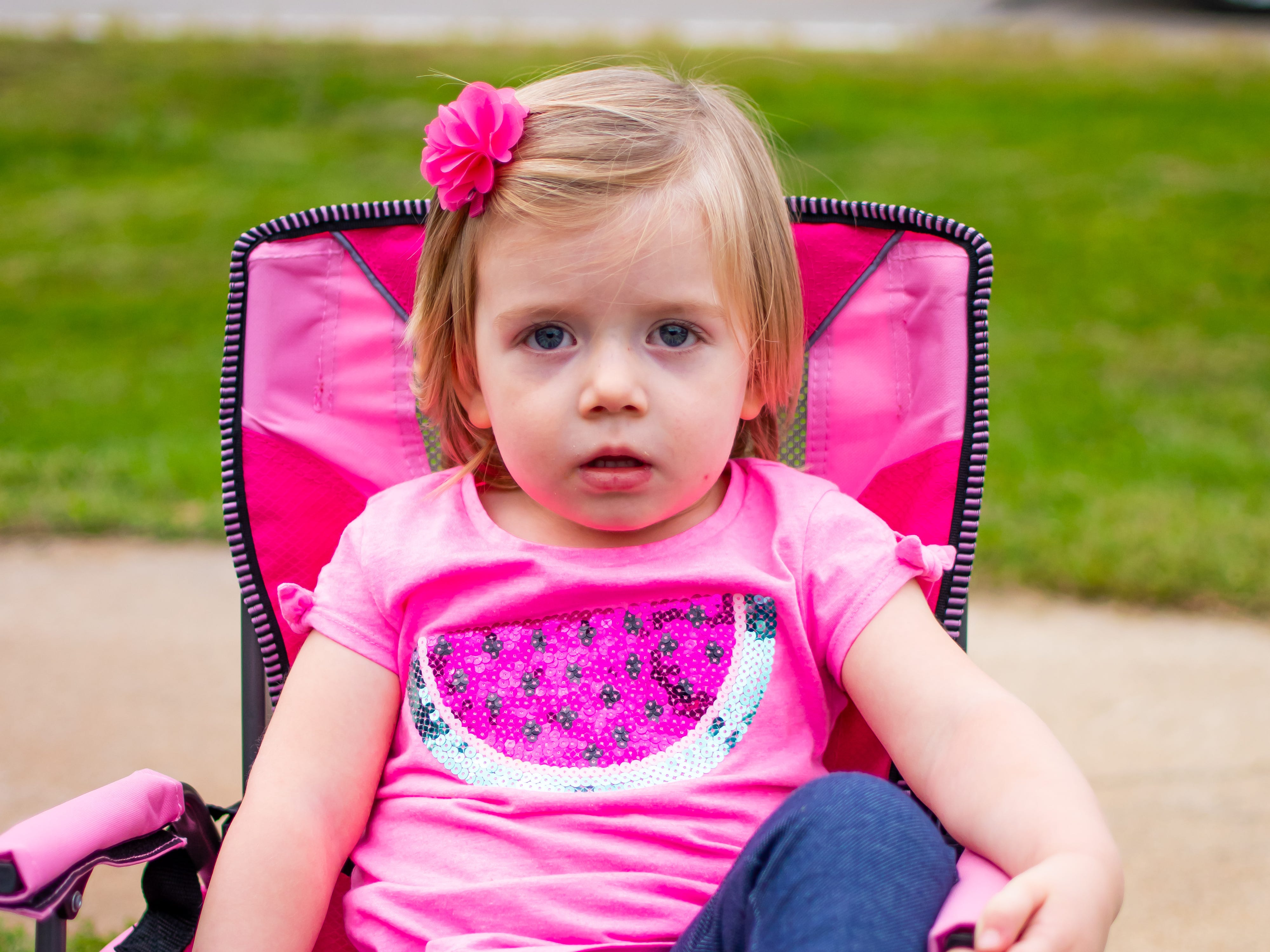 Nora Miller, 2, of Waukee waits  for the Waukee Homecoming Parade on Thursday, September 27, 2018 in Waukee.