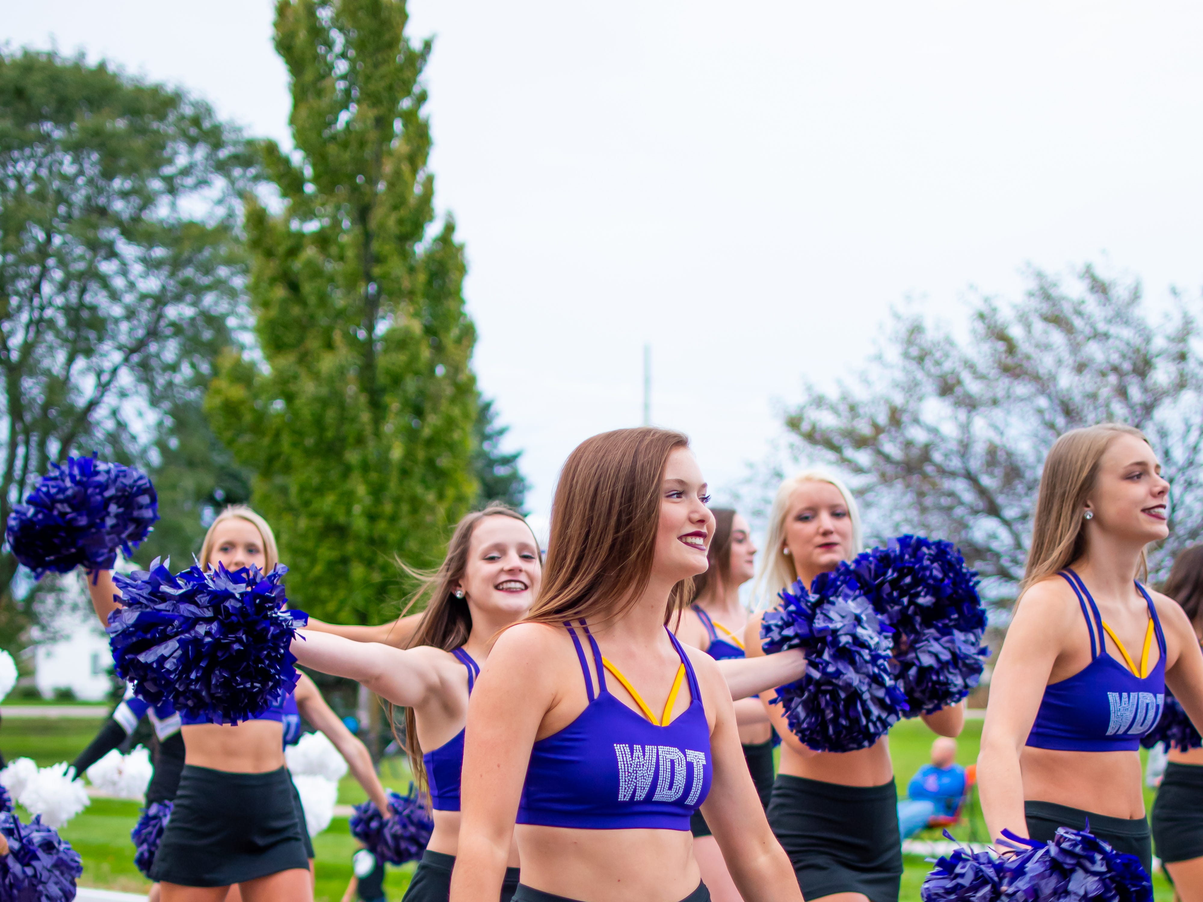 The Waukee high school dance team doesn't miss a beat at the Waukee Homecoming Parade on Thursday, September 27, 2018 in Waukee.