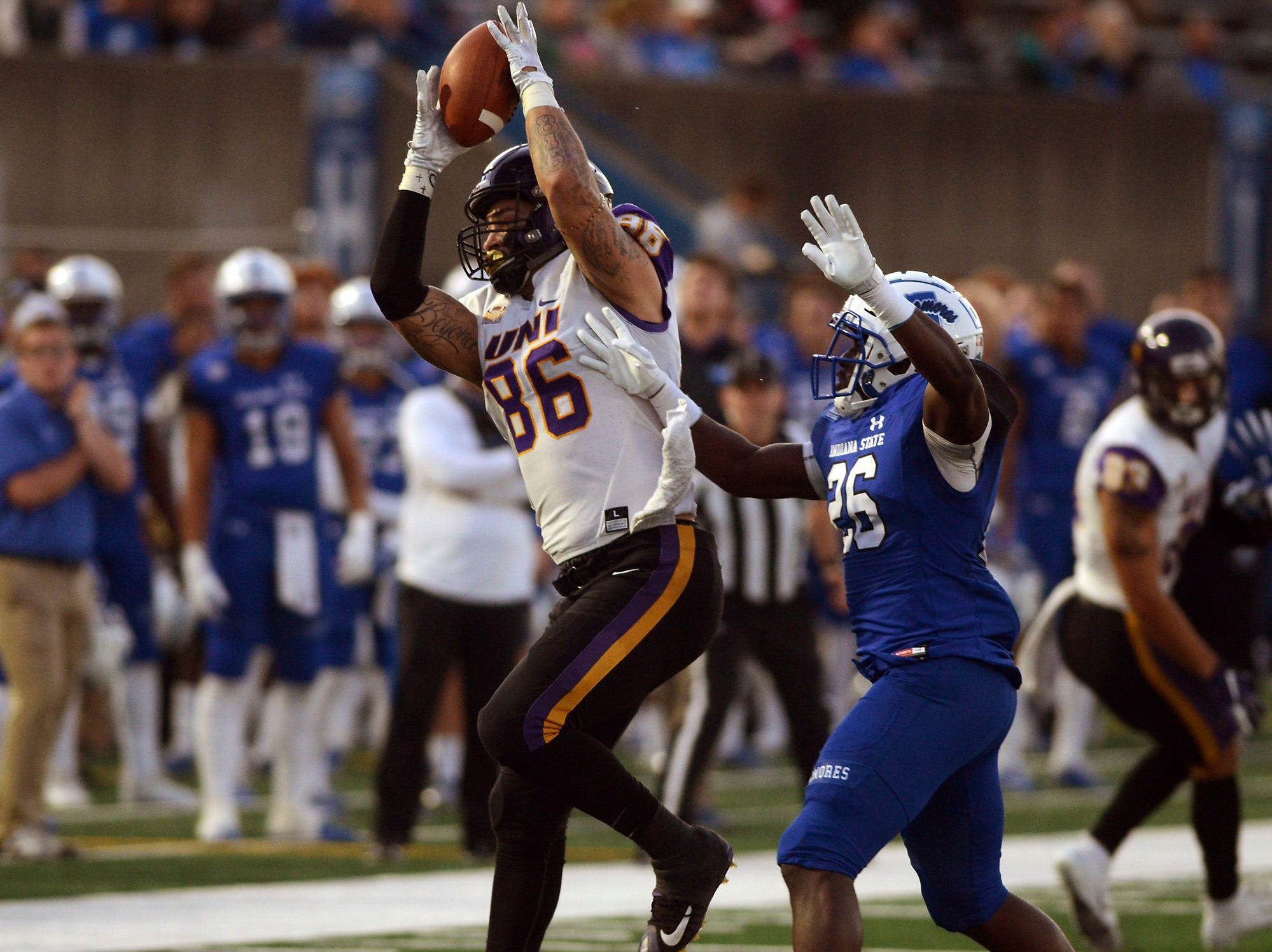 Northern Iowa's Briley Moore catches a pass over Indiana State's Jamal Jones during the first half of an NCAA college football game Thursday, Sept. 27, 2018, in Terre Haute, Ind.