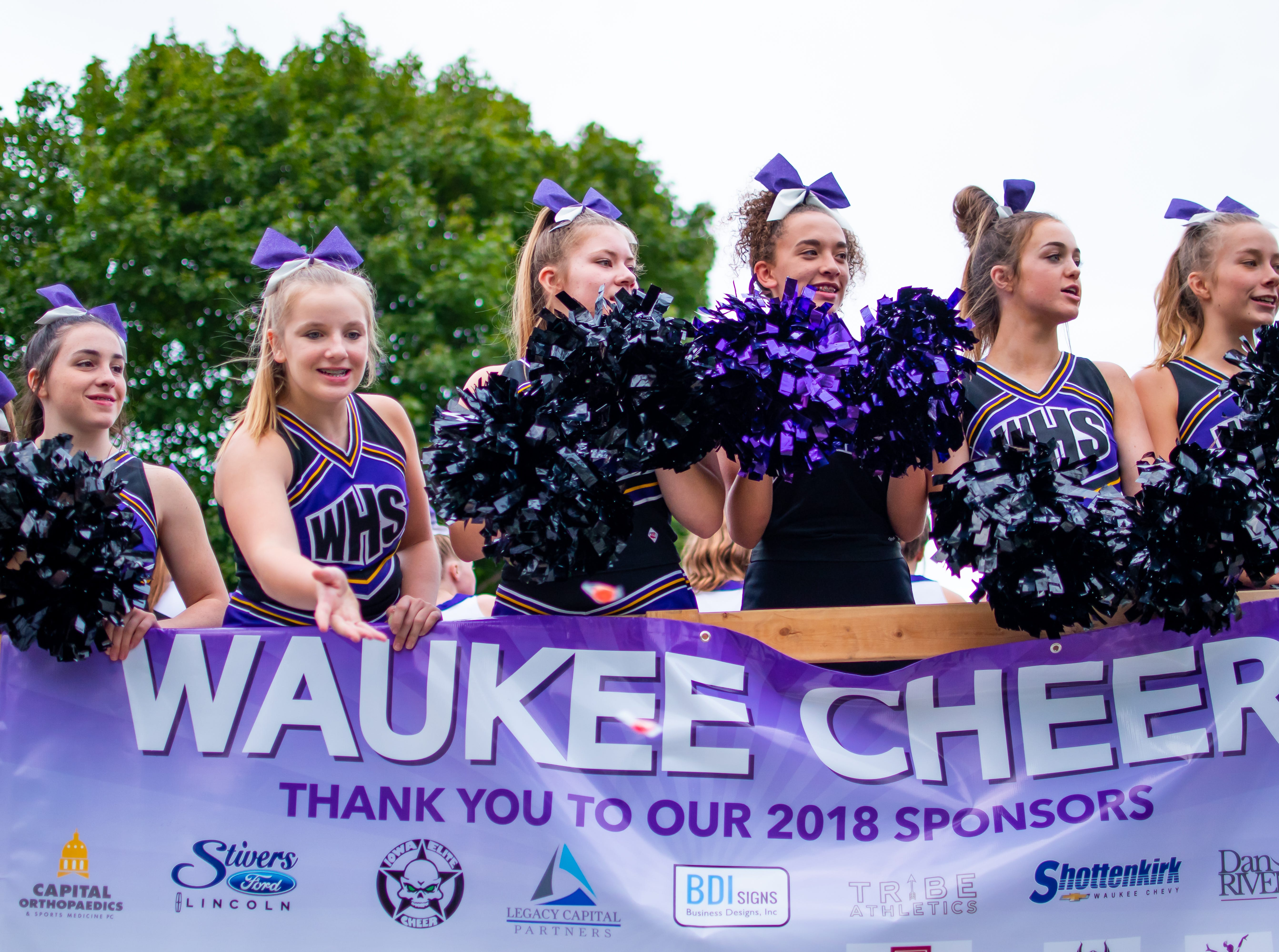 Waukee cheerleaders perform at the Waukee Homecoming Parade on Thursday, September 27, 2018 in Waukee.
