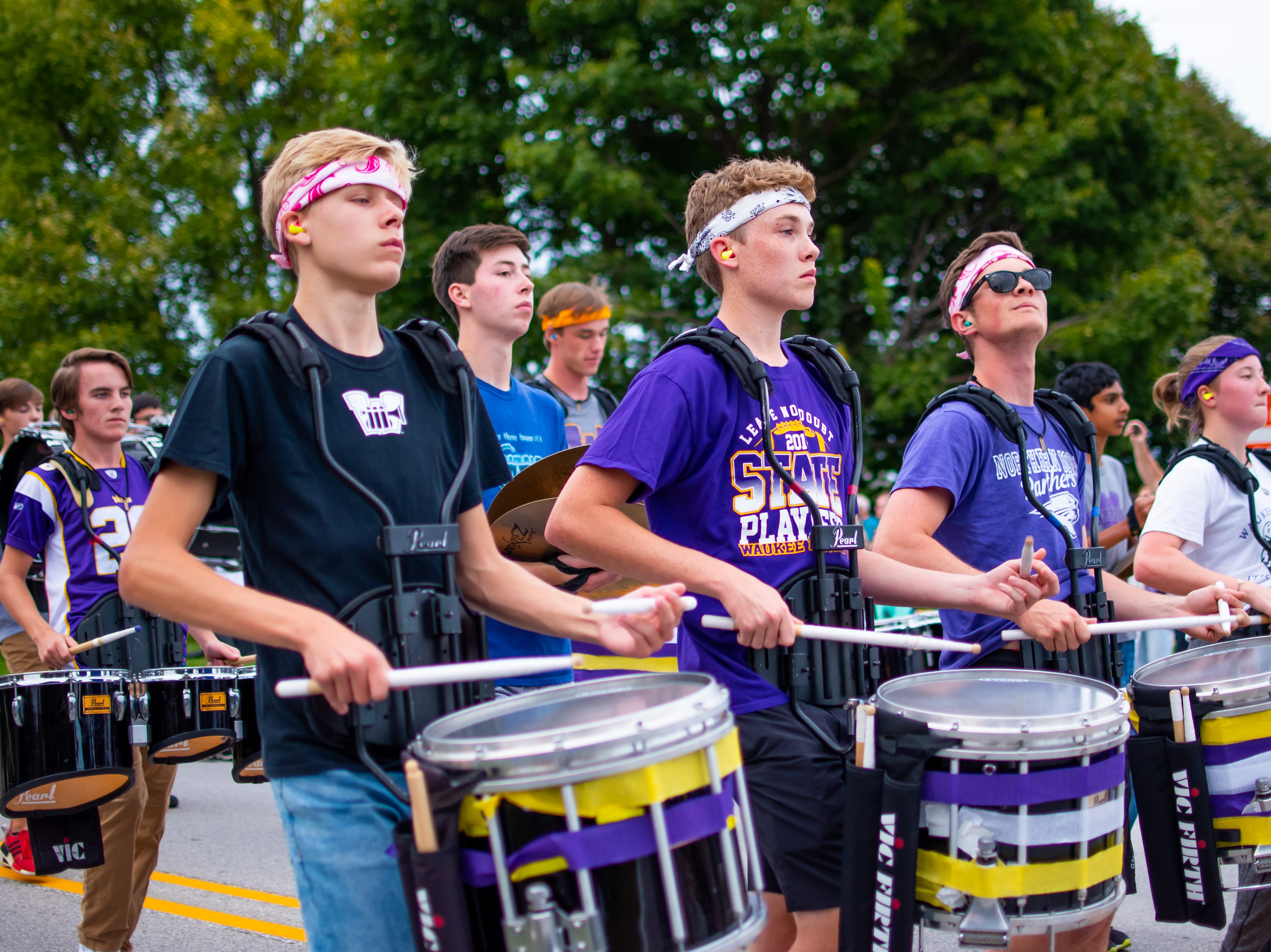 Waukee high school drum line keeps the Waukee Homecoming Parade on beat on Thursday, September 27, 2018 in Waukee.