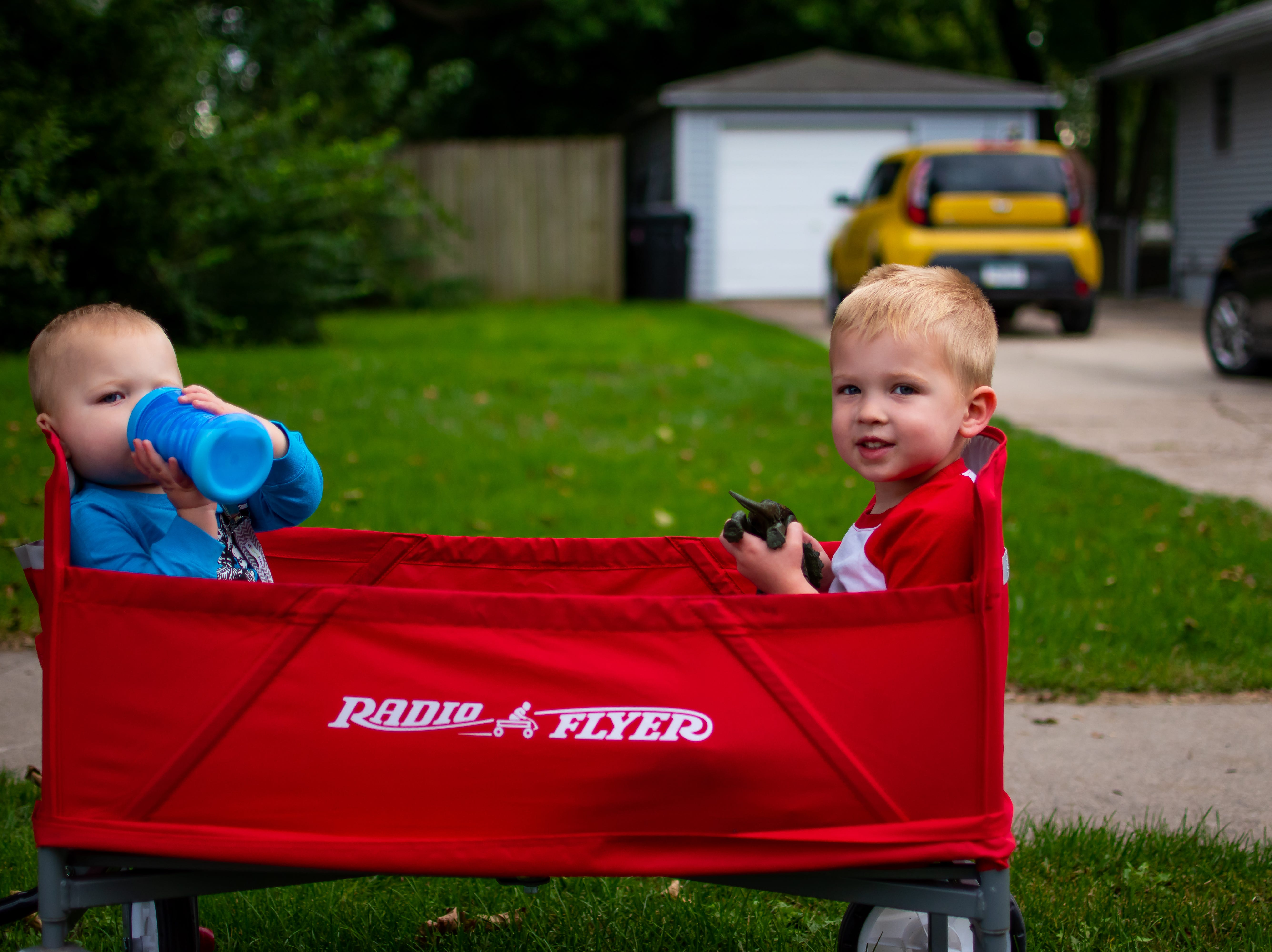 Crew, 1, and Case Theulen, 3, both of Waukee wait  for the Waukee Homecoming Parade on Thursday, September 27, 2018 in Waukee.