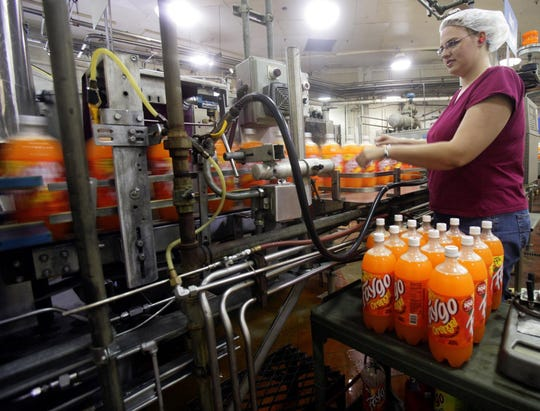 In August 2007, Quality Control Intern Amy Myers of LaSalle, works the line at Faygo in Detroit. 2007 was Faygo's 100th year anniversary.