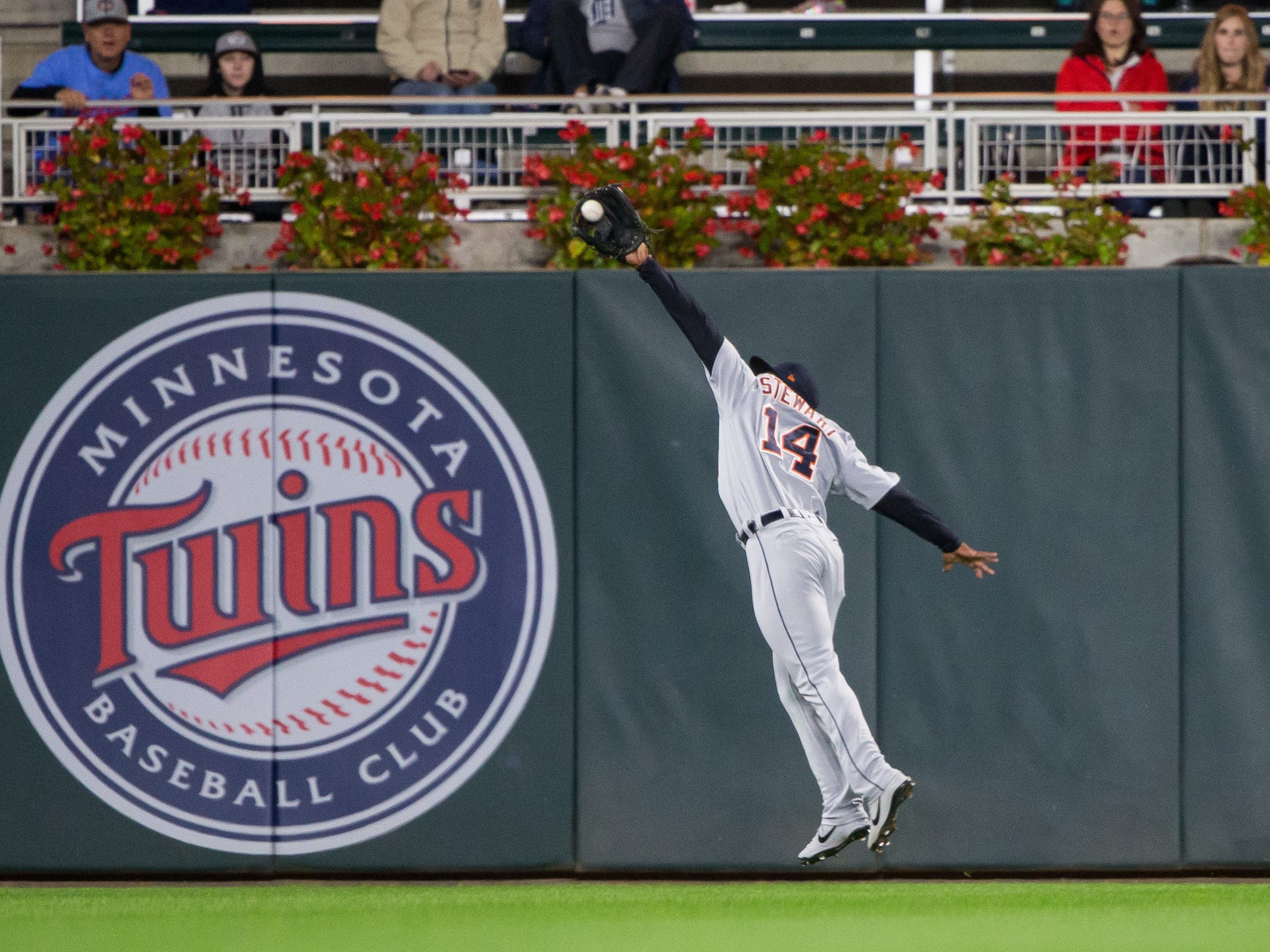 Sept. 27, 2018 in Minneapolis, Minn.: Detroit Tigers outfielder Christin Stewart makes a leaping catch in the first inning against Minnesota Twins at Target Field.