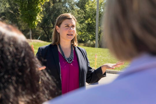 Democratic nominee for the Michigan 8th Congressional District Elissa Slotkin speaks with volunteers at Spencer Elementary School in Brighton, Mich., Sunday, September 23, 2018.
