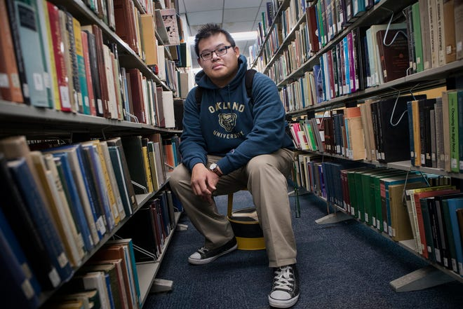 Tony Zhang, 20, of Auburn Hills takes a break from studies at Oakland University in Rochester, Mich., on Thursday.