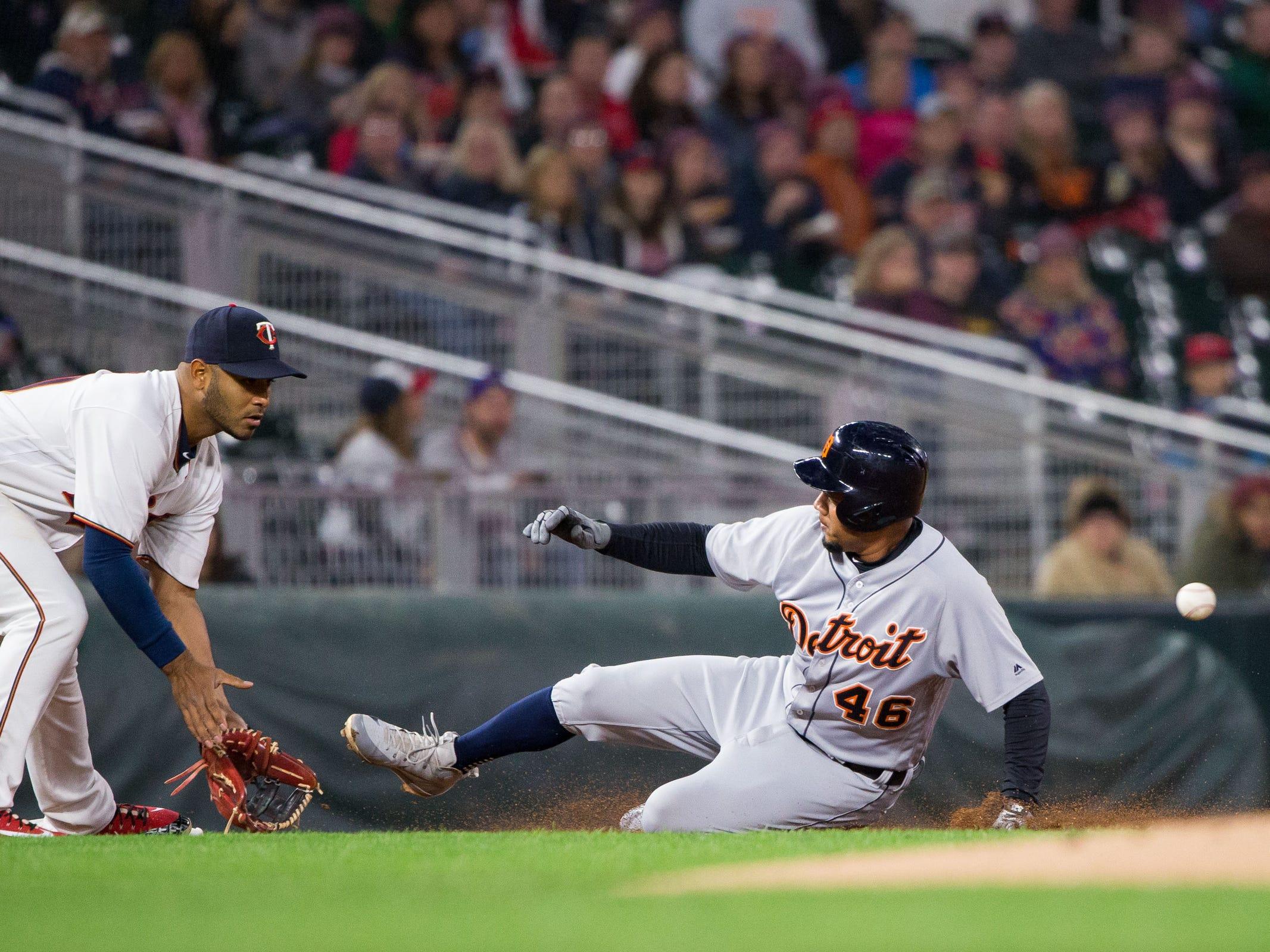 Sept. 27, 2018 in Minneapolis, Minn.: Detroit Tigers third baseman Jeimer Candelario slides into third base in the first inning against Minnesota Twins third baseman Gregorio Petit at Target Field.