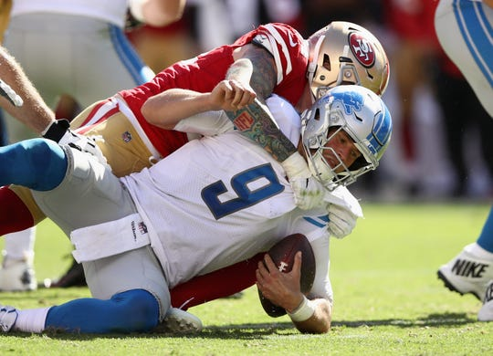Matthew Stafford is sacked by Cassius Marsh of the 49ers on Sept. 16.