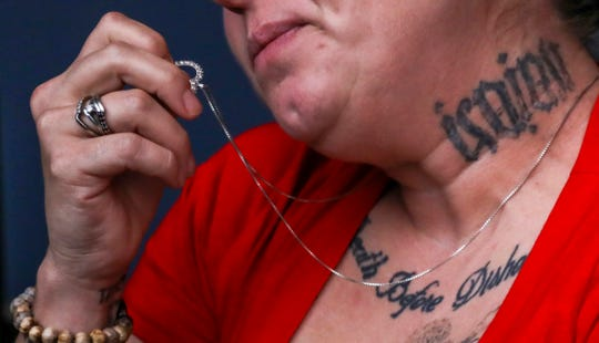 A felon, recently off probation, wants a tattoo of an old boyfriend's name removed from her neck and reached out to the the Freedom Ink program held at the Detroit Hispanic Development Corporation in Detroit that removes tattoos for free with the volunteers from Beaumont Hospital's dermatology residents, photographed on Thursday, Sept, 13, 2018.