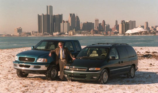 Detroit Free Press auto critic Tony Swan with the 1997 Ford F-150 and the 1996 Chrysler Town and Country minivan as the Free Press picks for the North American Car and Truck of the year for 1996.  This is on Belle Isle with the city of Detroit in the background in December 1995.