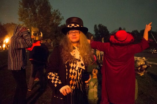 Chris Brennan of Detroit listens to music and enjoys the atmosphere during a full moon party at Lincoln Street Art Park in Detroit. The monthly event attracts a variety of people, often in imaginative costumes, and usually includes performances and dancing.