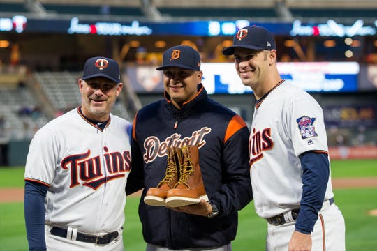Sept. 27, 2018 in Minneapolis, Minn.: Detroit Tigers designated hitter Victor Martinez, center, is honored before the game with Minnesota Twins bench coach Derek Shelton, left, and first baseman Joe Mauer at Target Field.