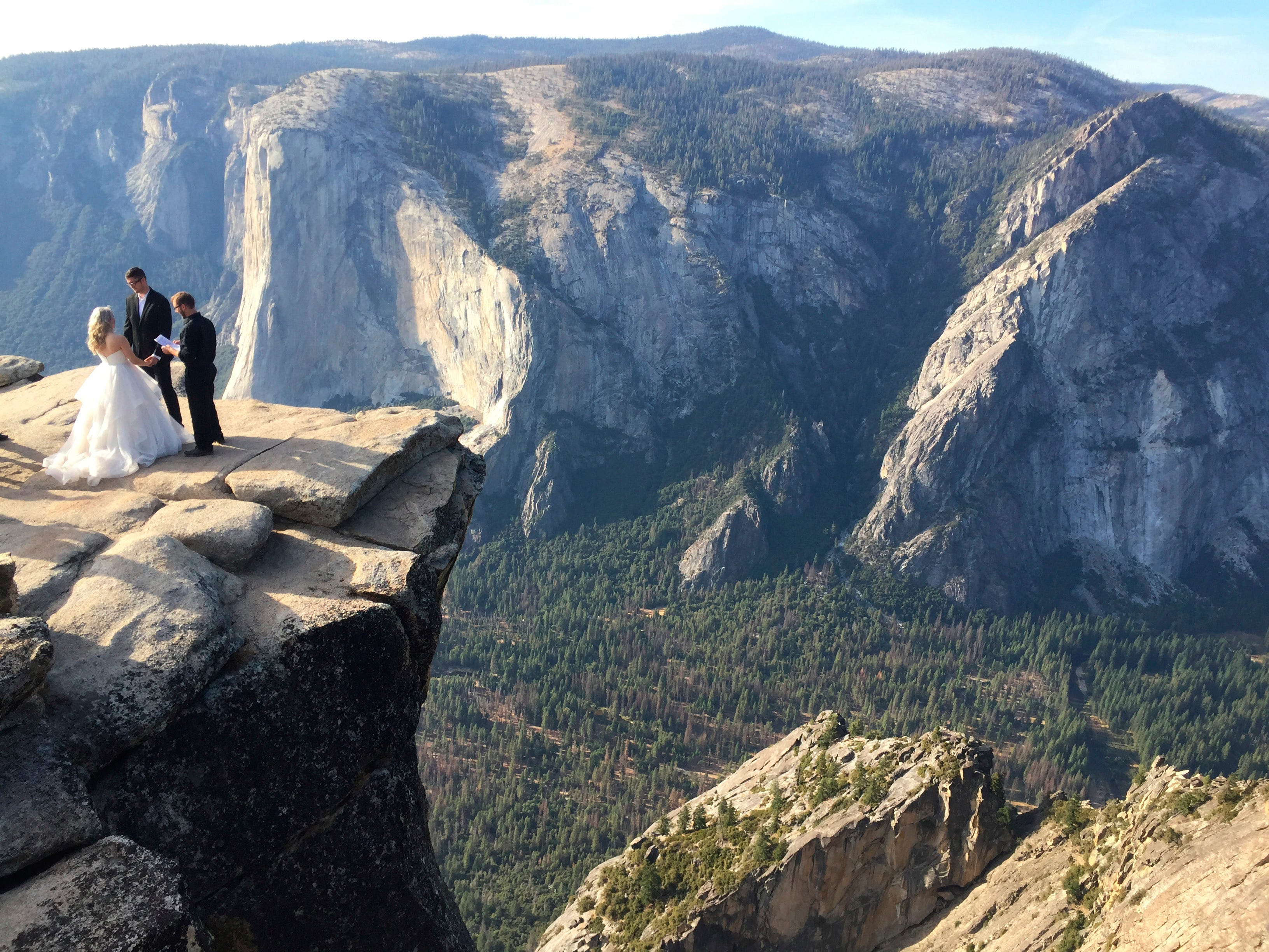 A couple wed at Taft Point in California's Yosemite National Park on Thursday, Sept. 27, 2018. The viewpoint overlooks Yosemite Valley, including El Capitan, a popular vertical ascent for rock climbers across the globe.