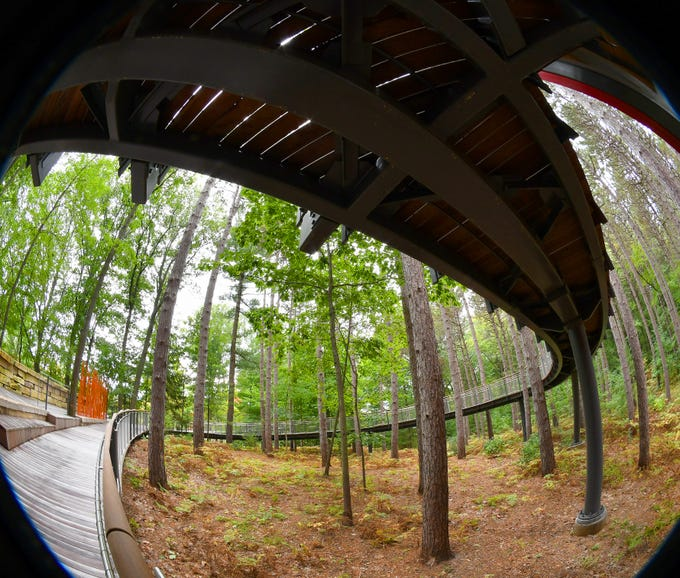 A quarter-mile-long  elevated Canopy Walk — the longest in the nation — will open to the public Oct. 7 in Midland, a new feature of the Dow Gardens' 54-acre Whiting Forest. To make the walk ADA-compliant, a huge, spiral section was built to take visitors up in the air amid the tree tops.