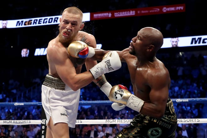 Floyd Mayweather Jr., right, made 27 appearances on HBO.