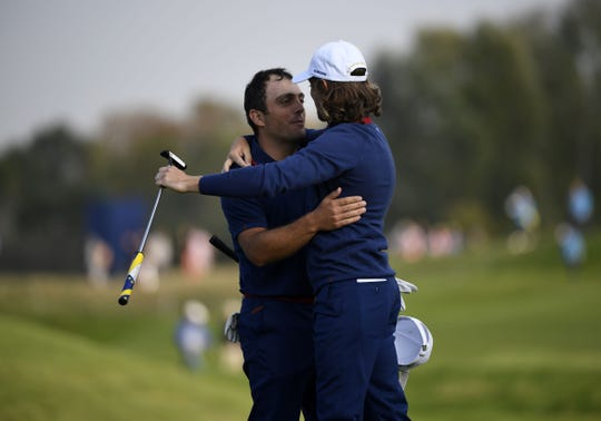 Europe's Tommy Fleetwood, right, celebrates with Francesco Molinari after winning  their foursomes match.