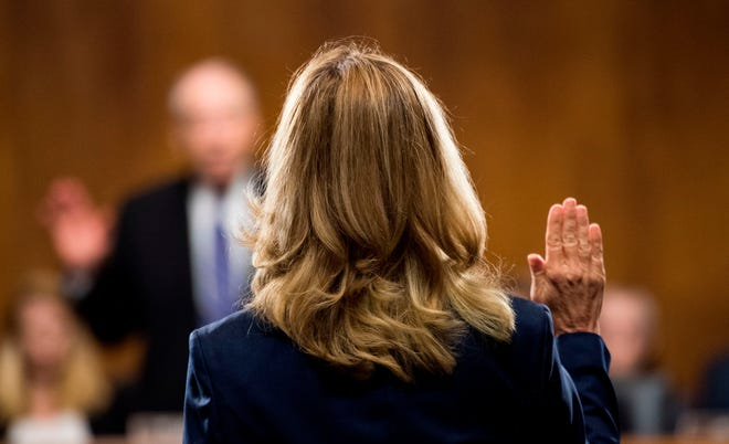 Dr. Christine Blasey Ford is sworn in by chairman Chuck Grassley, R-Iowa, on September 27, 2018.