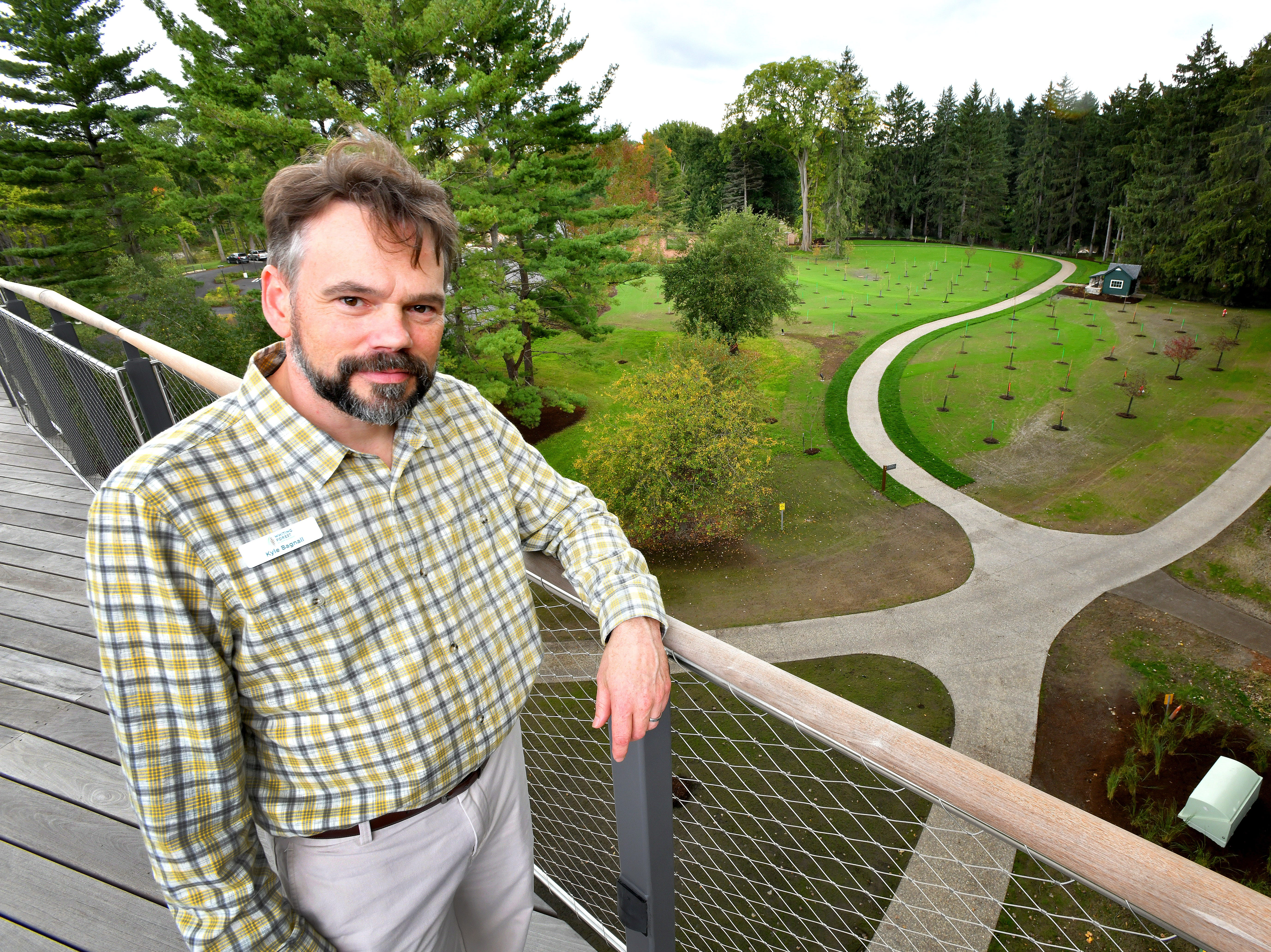 """Kyle Bagnall, program manager at Whiting Forest enjoys the view from the """"Orchard Arm.""""  """"It's going to be peak color in October,"""" observed Bagnall.  Just in time for the grand opening."""