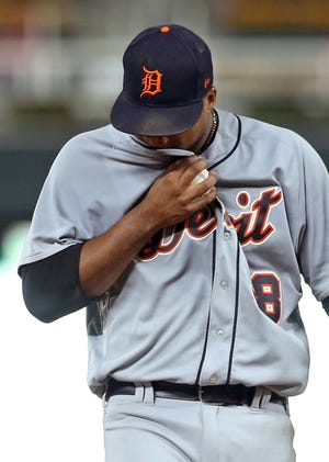 Tigers pitcher Francisco Liriano wipes his face before leaving in the third inning on Thursday.